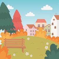 Landschaft im Herbst. Dorfhäuser, Bank und Bäume
