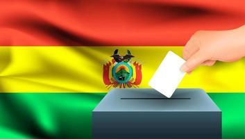 Hand, die Stimmzettel in Wahlurne mit bolivianischer Flagge setzt