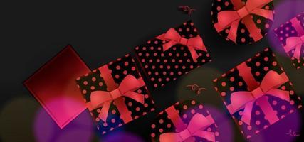 svart banner med presentaskar med rött band