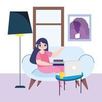 ung kvinna på den bärbara datorn hemma