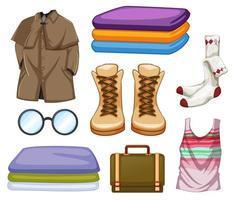 Satz von Mode-Outfits und Accessoires auf weißem Hintergrund