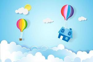 hus som hänger från färgglada ballonger i himlen