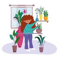 ung kvinna trädgårdsskötsel inomhus skyddad från covid-19