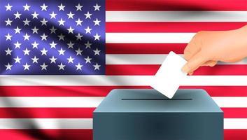 Hand legt Stimmzettel in Box vor amerikanischer Flagge