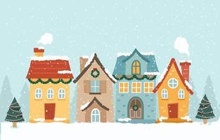 fyra hus täckt av snö under vintersäsongen