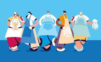 grupp servitörer med ansiktsmask och uniform