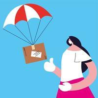 Frau, die Paketbox fängt, die mit Fallschirm herunterfällt