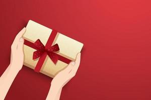 Hände halten Geschenkbox vektor