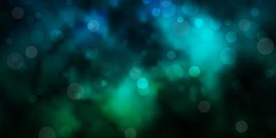 dunkelblaue und grüne Textur mit Kreisen.