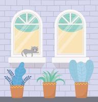 byggnad fasad med katt på fönstret