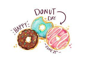 Nette Donuts Set mit Schriftzug im Donut Day vektor