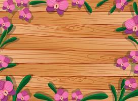 leerer Holztisch mit Blättern und rosa Orchideen