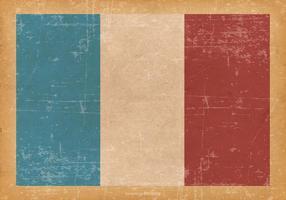Frankrike flagga på Old grunge bakgrund vektor