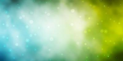 ljusblå och grön bakgrund med stjärnor.
