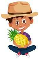 Junge hält Ananas