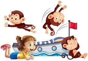 flicka och glada apor som hoppar på sängen