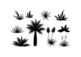 Free Tropisk växt och gräs i silhuett vektor