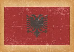 Albaniens flagga på grunge bakgrund