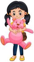 glad tjej som håller nallebjörnen