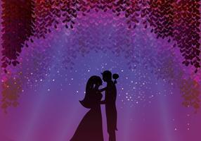 Bräutigam und Braut unter Blüte Wisteria