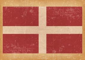 Flagga av Malteserorden på grunge bakgrund vektor