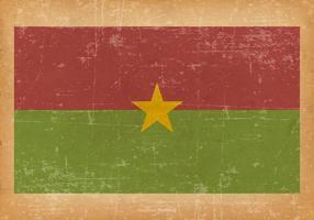 Flagga av Burkina Faso på Grunge Bakgrund