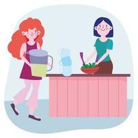 kvinnor lagar mat i köket
