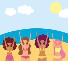 kvinnor på stranden gör sommaraktiviteter
