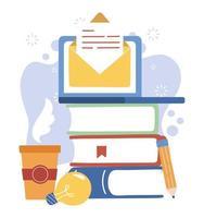 bärbar dator, böcker och kaffemugg