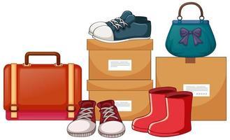 väskor och skor med lådorna på vit bakgrund