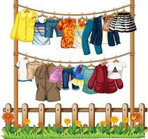 kläder som hänger på en klädstreck med staket och blommelement på vit bakgrund