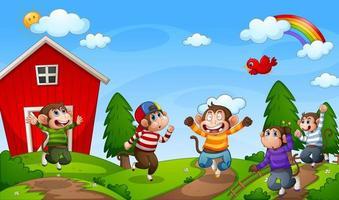 fem små apor som hoppar på gårdsplatsen