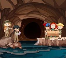 scen med grupp spejdare som utforskar grottan vektor