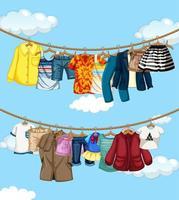 många kläder hängande på en linje på blå himmel bakgrund