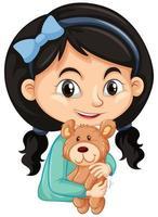 süßes Mädchen, das Teddybär auf weißem Hintergrund umarmt