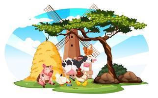 gårdsplats med husdjur och väderkvarn på gården