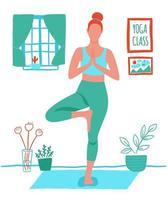kvinna som utövar yoga hemma