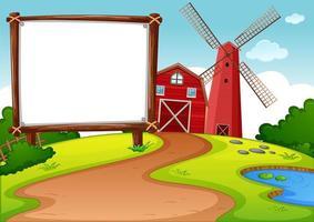 tomt banner i gård med röd ladugård och väderkvarnsplats