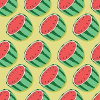 vattenmelonhalvor med skugga på mintgrön bakgrund.