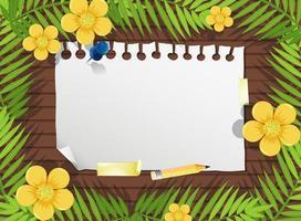 ovanifrån av blankt papper på bordet med blad och gula blommaelement