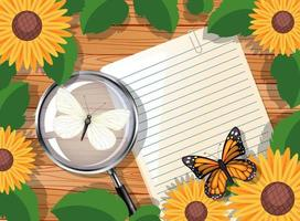 ovanifrån av blankt papper på bordet med blad och solroselement