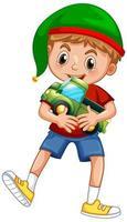 süßer Junge, der Weihnachtsmütze trägt und mit seinem Spielzeug auf weißem Hintergrund spielt