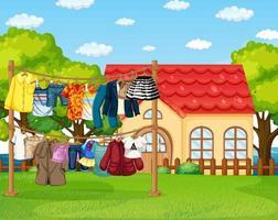 många kläder som hänger på en linje i utomhusscenen vektor