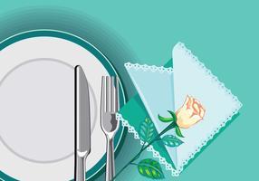 Närbild på plåt med kniv och gaffel och servett