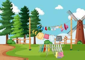 kläder hängande på rad i gården vektor