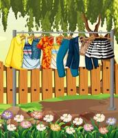 Kleider hängen an einer Wäscheleine mit Zaun und Blume in der Gartenszene vektor