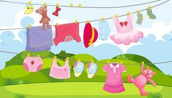 barnkläder på en klädstreck med barntillbehör i utomhusscenen