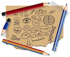 handritade vetenskapliga element på papper med många pennor