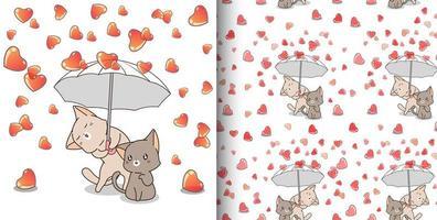 katter som håller paraply medan det regnar hjärtmönster