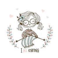 Ein süßes Mädchen strickt einen Schal